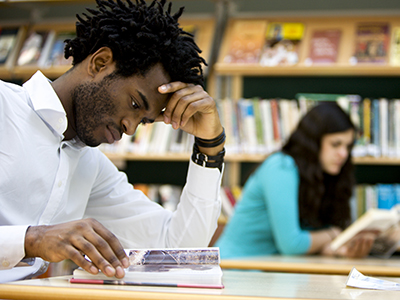 African-American student studying in library
