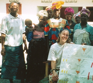 Annie with village women following a health class about vaccinations