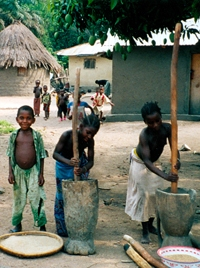 Neighborhood kids pounding rice